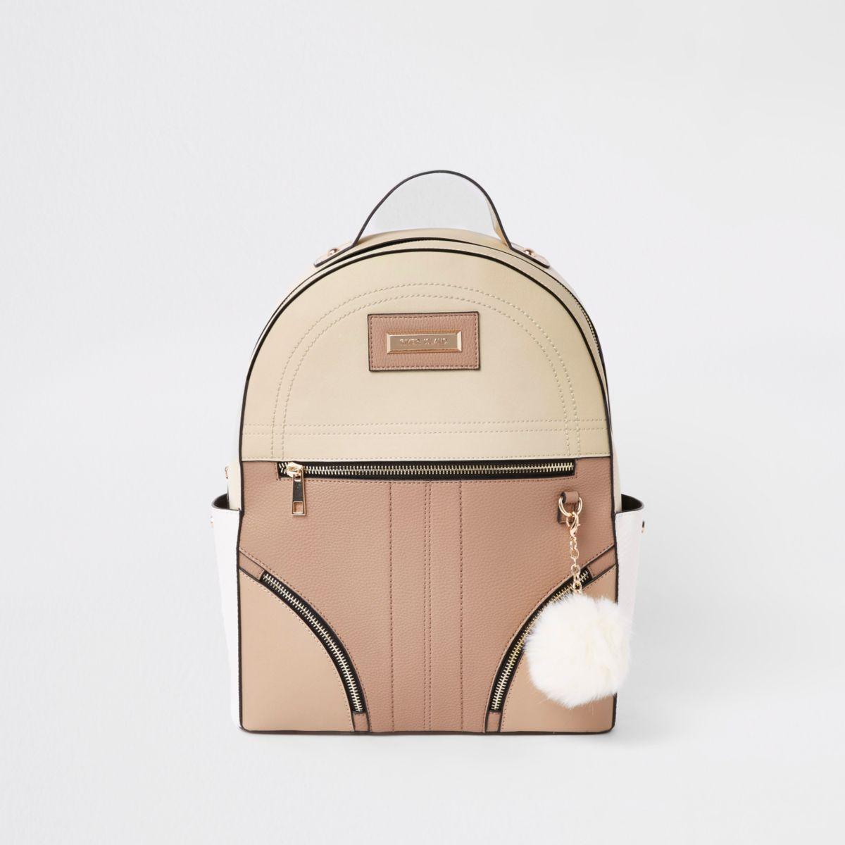 Beige zip front back pack