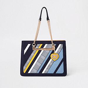 Blauwe geruite en gestreepte handtas met kettinghengsel