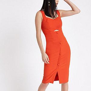 Robe moulante mi-longue orange boutonnée sur le devant