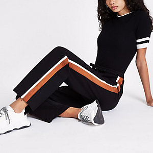 Black orange striped side wide leg joggers