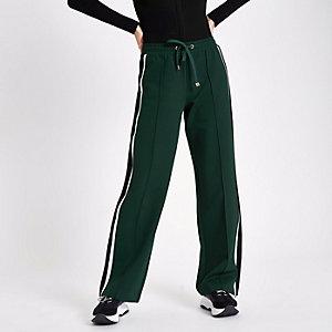 Pantalon de jogging vert à bande latérale