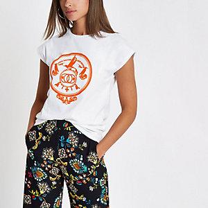 White orange print cap sleeve T-shirt