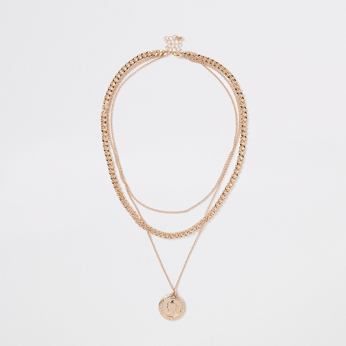Gold tone pendant and chain layered necklace