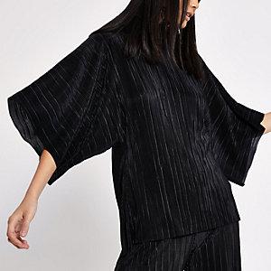 Zwarte plissé hoogsluitende top met split op de rug