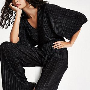 Haut noir plissé avec ceinture