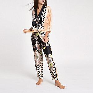 Pantalon de pyjama en satin à fleurs noir