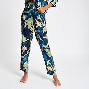 Blauwe satijnen pyjamabroek met bloemen en wijde pijpen