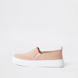 Pink slip on plimsolls