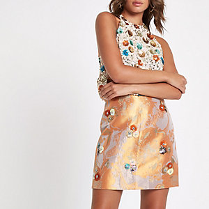 Orange floral embellished mini skirt