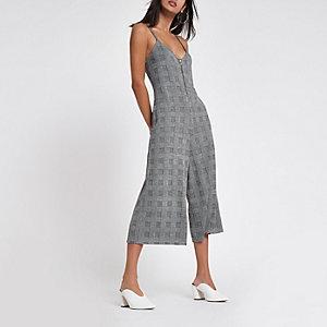 Combinaison jupe-culotte grise à carreaux zippée sur le devant