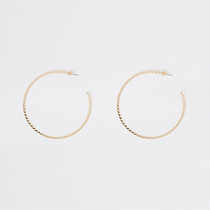 Gold tone large twisted hoop earrings