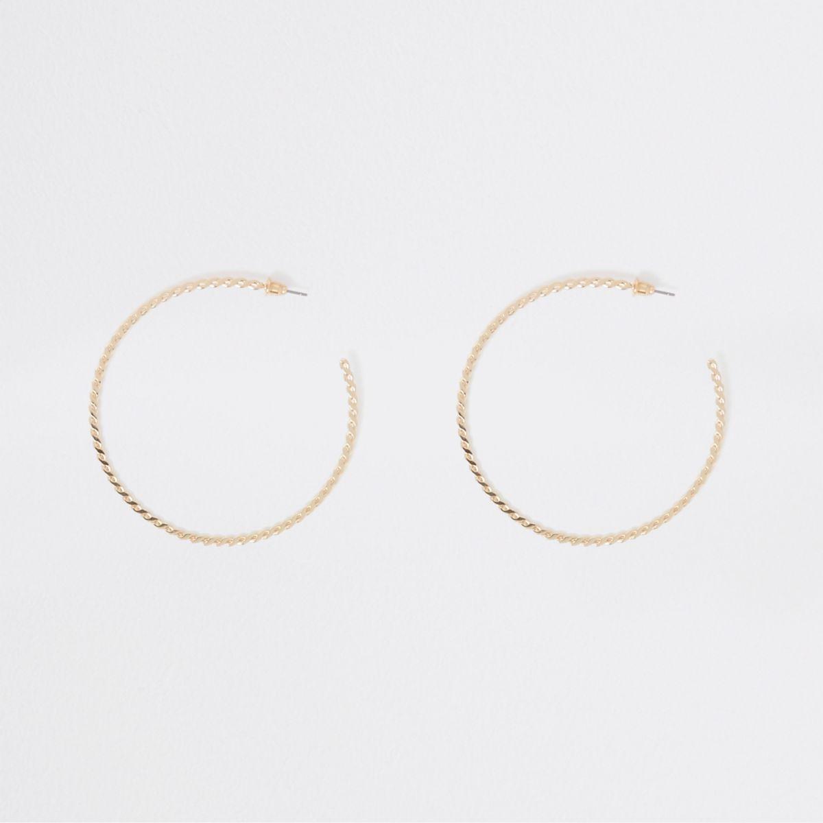 Gold tone large twisted hoop earrings