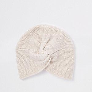 Beige gebreide gedraaide hoofdband