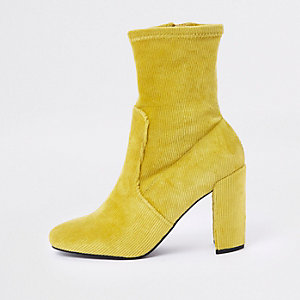 Yellow faux suede block heel sock boots