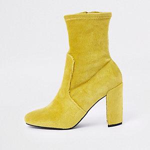 Yellow faux suede block heel sock boots