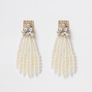 Gold tone faux pearl tassel stud earrings