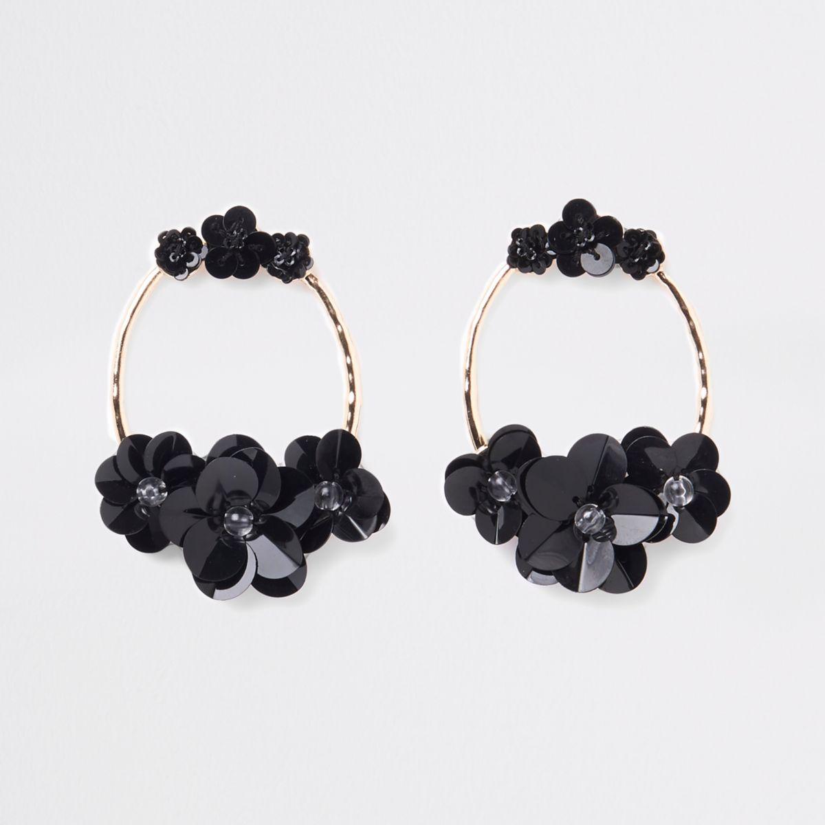 Zwart-met-goudkleurige ronde oorringen met lovertjes
