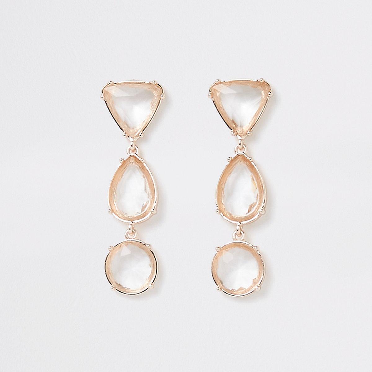 Clous d'oreilles dorés avec pendants à pierres