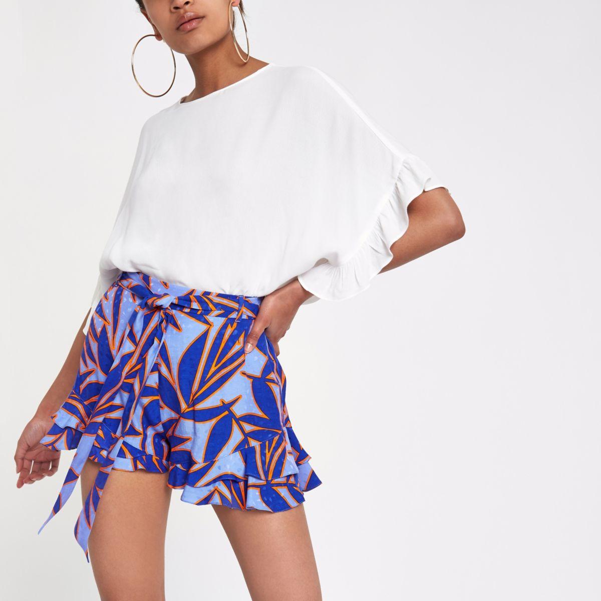 Blue tropical print frill hem shorts