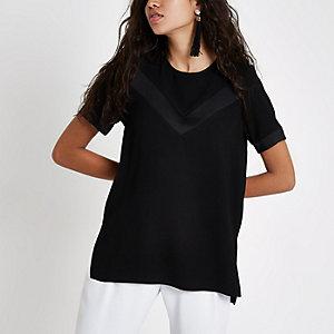 Zwarte ruimvallende blouse