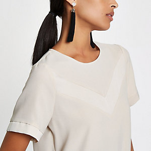 Beige ruimvallende blouse