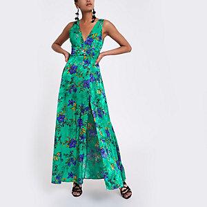 Groene gebloemde diepuitgesneden maxi-jurk met strik op de rug
