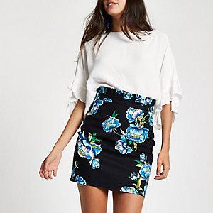 Mini-jupe noire à fleurs et taille froncée