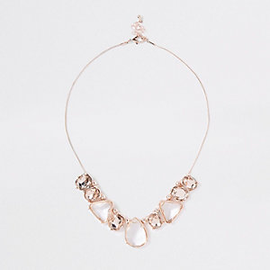 Collier or rose avec pendentifs pierres