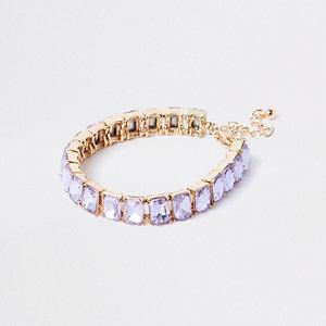 Bracelet doré orné de perles lilas carrées