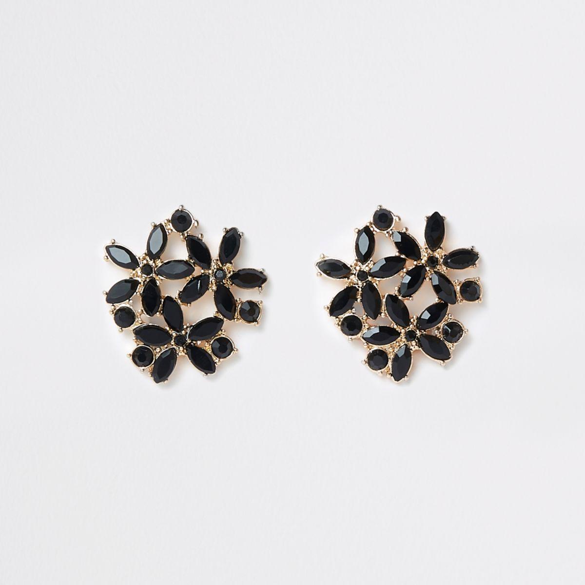 Goldene Clip-Ohrringe mit schwarzen Schmucksteinen