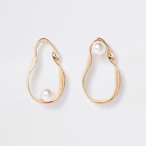 Gold tone twist pearl drop earrings
