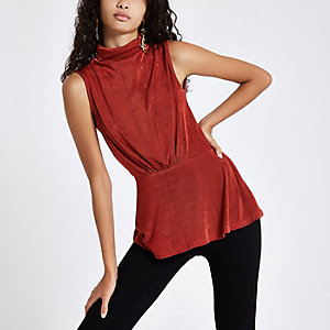 Red sleeveless roll neck top