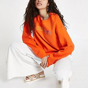 Oranje croped sweatshirt met 'couture'-print