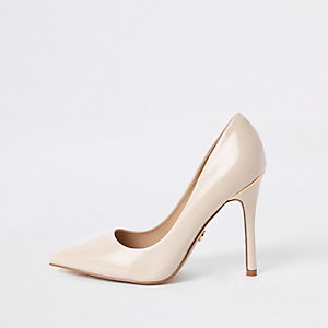 Pink porcelain patent pumps
