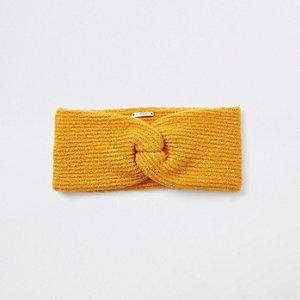Gelbes Stirnband aus Strick