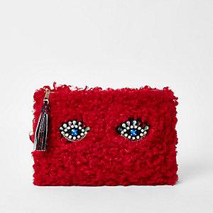 Red fleece embellished eye clutch bag