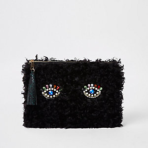 Black fleece embellished eye clutch bag