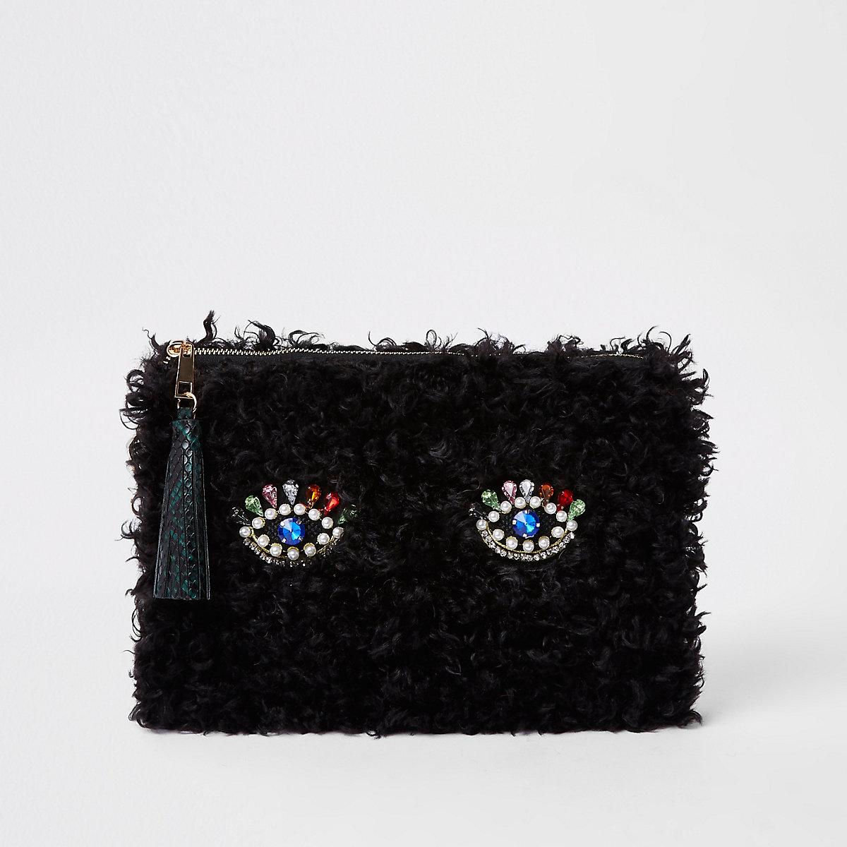 Pochette imitation mouton noire avec œil
