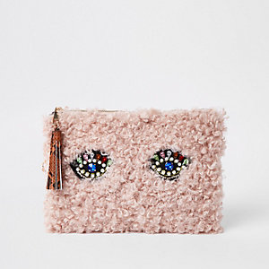 Light pink borg embellished eye clutch bag