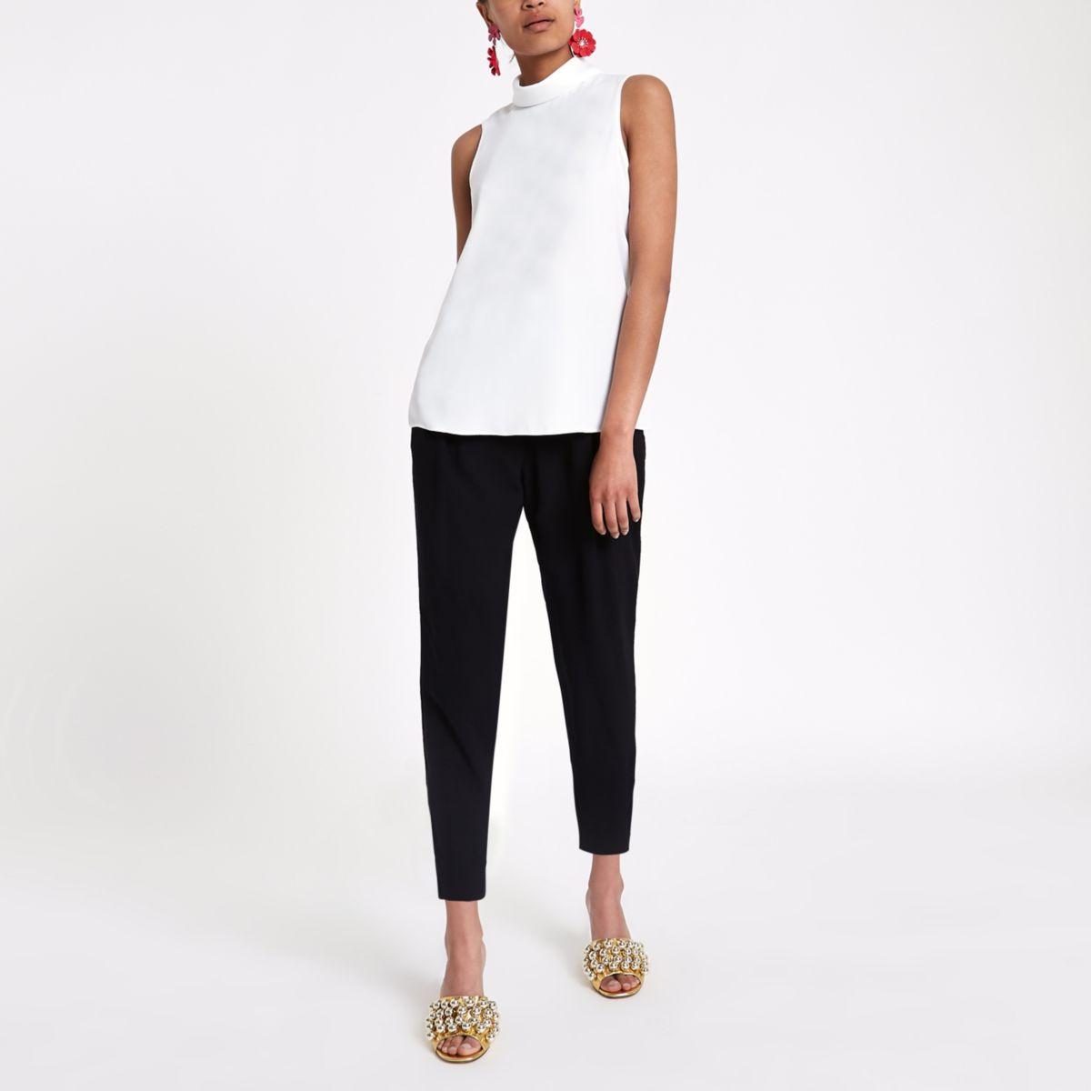 White sleeveless roll neck top
