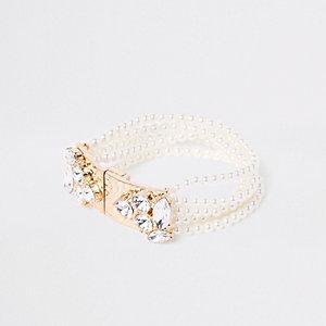 Goudkleurige brede magnetische armband met parel en siersteentjes