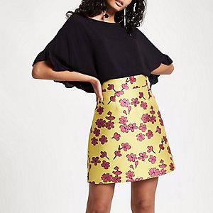 Mini-jupe jaune en jacquard à fleurs