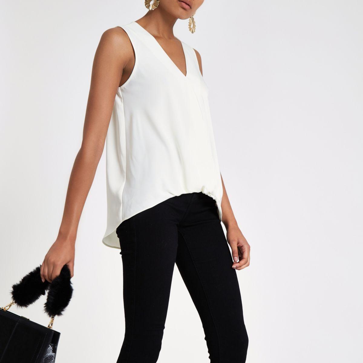 Cream wrap tuck front sleeveless blouse