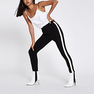 Petite black tape side skinny pants