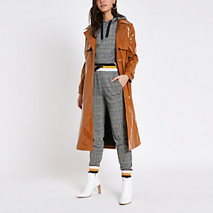 Brown vinyl tie waist trench coat
