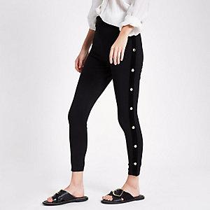 Schwarze Leggings mit seitlichem Druckknopfverschluss