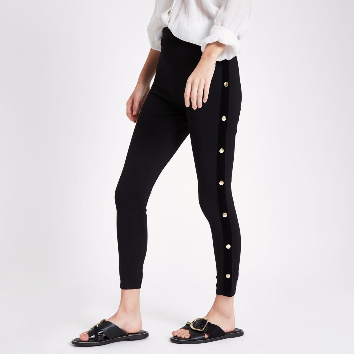 Zwarte legging met drukknopen opzij