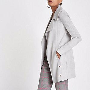 Lange, graue Jacke mit Druckknöpfen