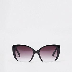 Lunettes de soleil glamour noires à verres découpés