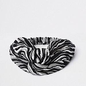 Brede gedraaide grijze hoofdband met zebraprint